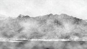 Thumbnail Jagged mountains in the fog in Black & white
