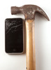 Thumbnail Smashed smart phone with hammer