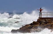 Thumbnail Man watches Hurricane Irene waves