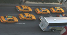 Thumbnail Taxi cabs and a bus in New York City