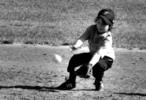 Thumbnail Tee ball player fields a grounder