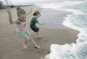Thumbnail Two children playing in the surf