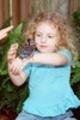 Thumbnail Little girl holds baby blue jay on her arm