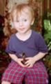 Thumbnail Little boy holds baby blue jay