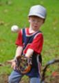 Thumbnail Little boy catching a baseball