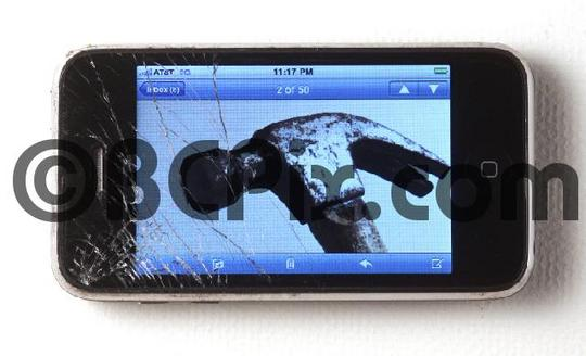 Pay for Cracked smart phone with photo of hammer on its screen