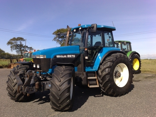 Guy Fixing Tractor : New holland tractor workshop service