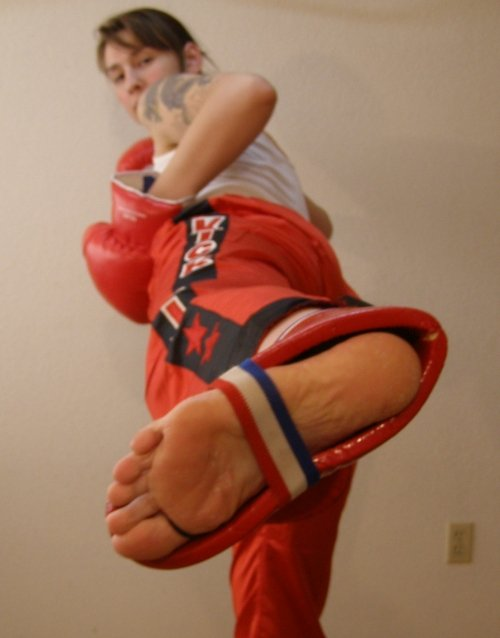 Kickboxing girl showing off her skills in a nude mixed figh 9