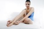 Thumbnail Woman painting her toenails