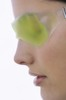 Thumbnail Woman with a gel eye mask, close up (studio)