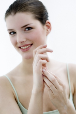Pay for Young woman face looking at the camera, smiling, Indoors