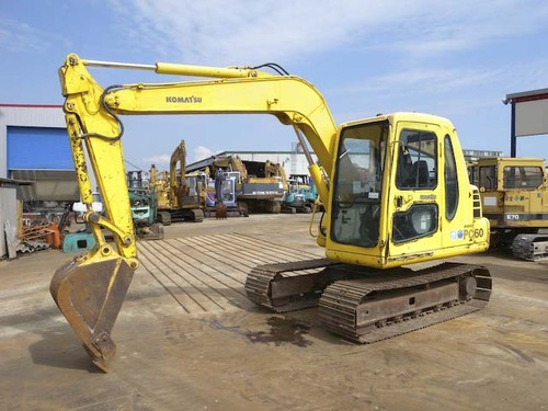 Pay for Komatsu PC60-7 manual collection. 4 x manuals