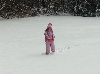 Thumbnail Girl Playing in Snow