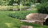 Thumbnail Garden furniture with a pond and two statues on the backgrou