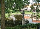 Thumbnail Reflecting pond and statues in a green garden