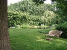 Thumbnail Garden furniture surrounded by trees and bushes