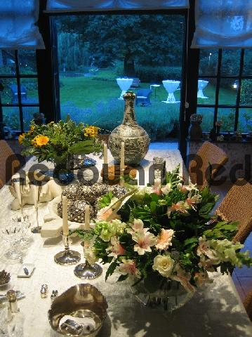 Pay for Stylishly decorated table with flowers, silverwork and potte