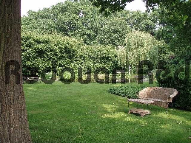 Pay for Garden furniture surrounded by trees and bushes