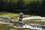 Thumbnail man cleaning a lake, oxygenating the water, enviroment care