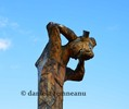 Thumbnail german pole totem, a man with his arms around his head