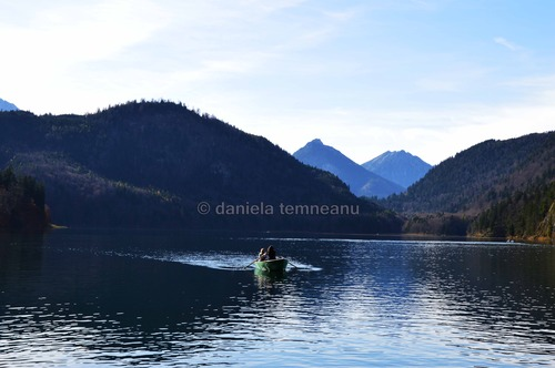 Pay for young women in a boat on lake Alpsee, Germany