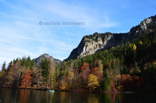 Pay for with the boat on lake Alpsee, autumn colours, Bavaria, Germa