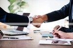Thumbnail Business people handshake contract