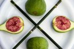 Thumbnail Fresh green figs with blades of horse tail on a plate
