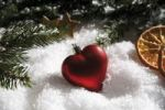 Thumbnail Heart-shaped Christmas tree bauble, branches of fir, dried orange slices and decorations on snow