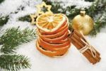 Thumbnail Dried orange slices with cinnamon sticks, a Christmas tree bauble, branches of fir and decorations on snow