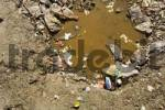 Thumbnail heavily polluted puddle of water