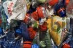 Thumbnail plastic bottles, compressed into a large bale and ready for recycling