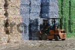Thumbnail Forklift-truck puts sorted and compressed bales of plastic bottles into interim storage. The plastic bottles are ready for recycling.