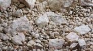 Thumbnail Different kinds of rock in a gravel bed