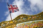 Thumbnail Flag of the United Kingdom above a carousel on the pier in Brighton, Sussex, Great Britain, Europe