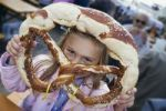Thumbnail Girl, 5, with pretzel, Oktoberfest, Munich, Upper Bavaria, Bavaria, Germany, Europe