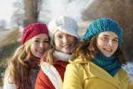 Thumbnail Teenage girls wearing hats, smiling and looking at the camera