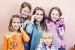 Thumbnail Group of children, girls from left 6, 11, 9 and 9 years old, boy 4 years old, on the phone
