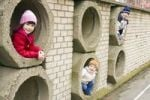 Thumbnail Children in hidey hole, little girls 6 and 3 years old, boy 7 years old