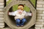 Thumbnail Little girl, 3 years old, in concrete tube
