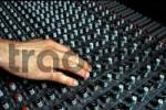 Thumbnail Hand on mixing console, music studio