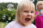 Thumbnail Girl, 3 years old, with soap bubbles
