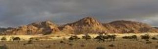 Thumbnail Granite rocks of the Tiras mountains in evening light in front of approaching rain, Namibia, Africa
