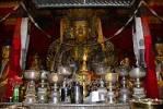 Thumbnail Buddhist cult figure Tsepame behind yak butter lamps Tsepak Lakhang Lhasa Tibet China