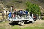 Thumbnail trekking group squeezes on the back of a Chinese truck Nyango Tibet China
