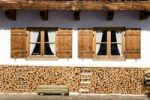 Thumbnail Stack of wood in front of a farm house window, Bavaria, Germany, Europe