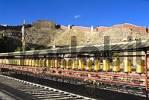 Thumbnail Long row of golden prayer wheels Pelkor Chöde Monastery Gyantse Tibet China