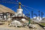 Thumbnail White stupa with colourful prayer flags against the blue sky and Mt. Everest Chomolungma Rongbuk Monastery Tibet China