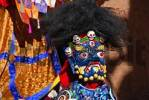Thumbnail Monk wears fearful and blue mask of a demon at festival in colourful decorated Rongbuk Monastery Tibet China