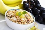 Thumbnail Exotic fruit muesli and grapes in a bowl